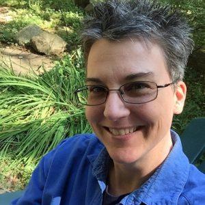 Web Developer Kathy Szczesny smiling while outside